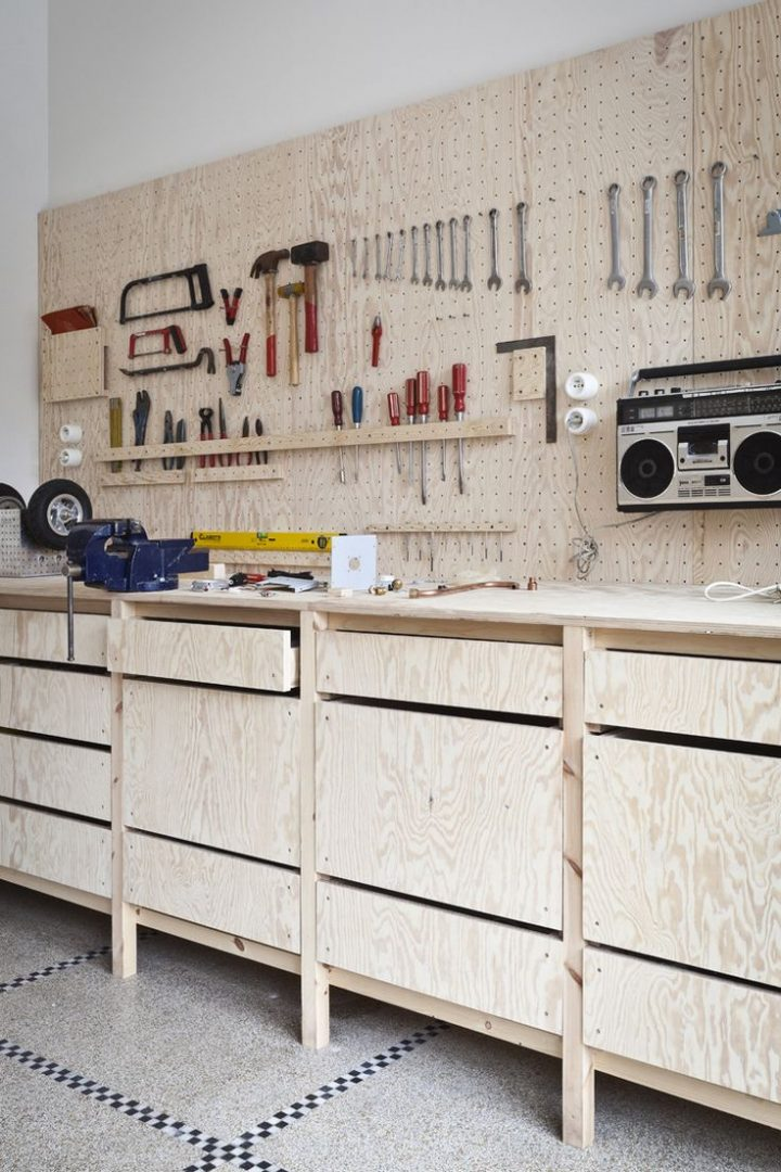 Bench is off floor. Pegboard is a good idea. I like the radio hanging up (keeps the bench clear).  – edelahaye