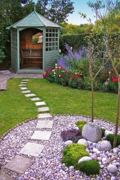 This garden design is stunning and simple. The gorgeous green seating area, the beautiful stone section and the perfectly laid out path – we love it!  – Lettie Boys-Stones