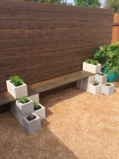 Easy DIY Succulent bench using cinder blocks and stained wood. Cheap and quick backyard garden project for beginners. Great spring garden project!  – growybear