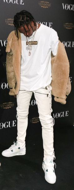 Loving this outfit from Travis with the LV Supreme tee, fur jacket and and white J's on white denim…clean  – Sandra Cuccu