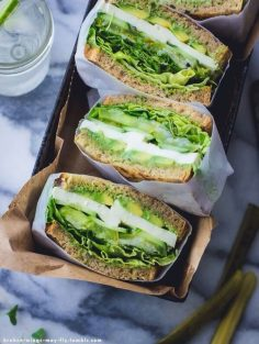 Mix basil, chives, garlic, mayonnaise, a little lemon: this is the sauce you will apply on good bread. Then fill your sandwich with salad, green tomatoes, cucumber and avocado.  – Jenny Aimée Dufraisse