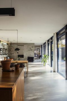 a pretty kitchen with gray waxed concrete floor  – archzinefr