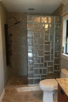 Don't be afraid to inject personality into a shower wall design. This glass block wall (which is still in the process of being finished) used multiple glass block patterns to create a mosaic beveled glass type of look. Click through for more idea…  – emmadomingo50
